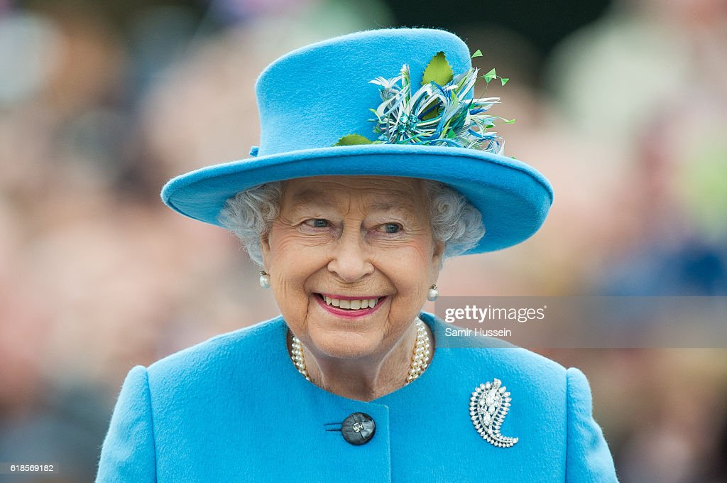Queen Elizabeth II tours Queen Mother Square on October 27, 2016 in Poundbury, Dorset.