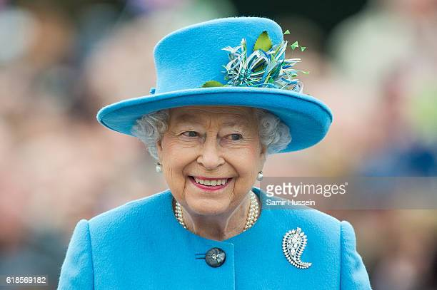 Queen Elizabeth II tours Queen Mother Square on October 27 2016 in Poundbury Dorset