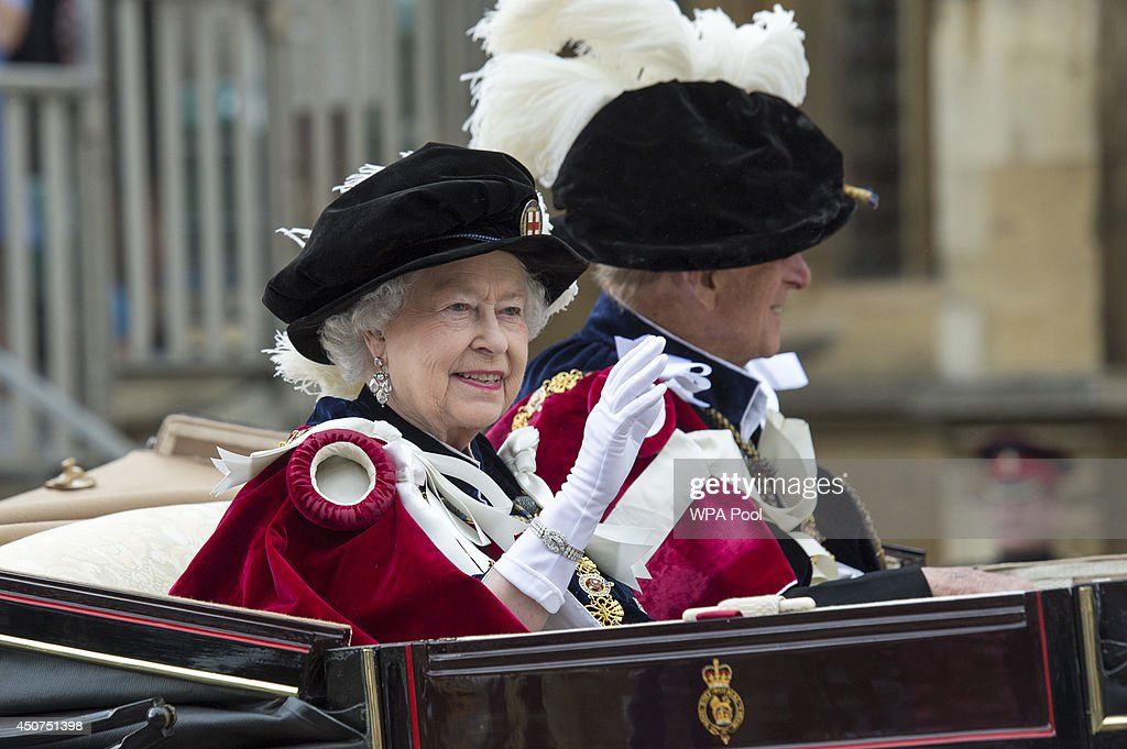 Queen Elizabeth II travels by carriage after the Most Noble Order of the Garter Ceremony on June 16, 2014 in Windsor, England. The Order of the Garter is the senior and oldest British Order of Chivalry, founded by Edward III in 1348. Membership in the order is limited to the sovereign, the Prince of Wales, and no more than twenty-four members.