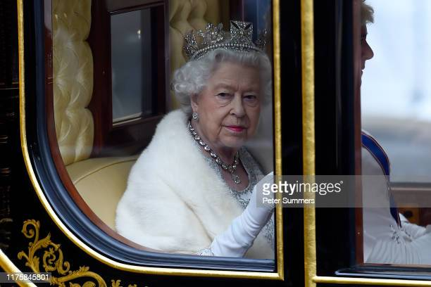 Queen Elizabeth II travels by carriage along The Mall ahead of the State Opening of Parliament at the Palace of Westminster on October 14, 2019 in...