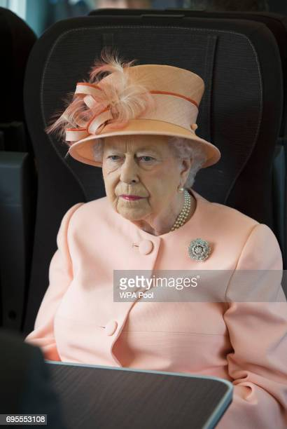 Queen Elizabeth II travels by train between Slough train station and Paddington Station to mark the 175th anniversary of the first train journey by a...