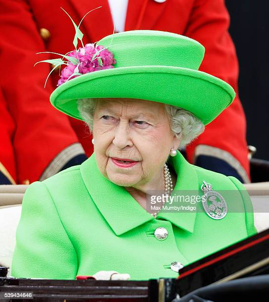 Queen Elizabeth II travels down The Mall from Buckingham Palace in a horse drawn carriage during Trooping the Colour this year marking her 90th...