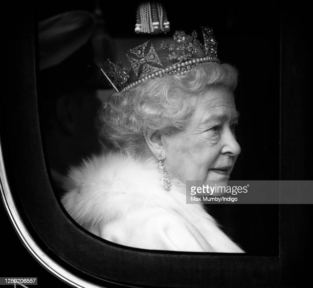 Queen Elizabeth II travels down The Mall, from Buckingham Palace to the Palace of Westminster, in the horse drawn Irish State Coach to attend the...