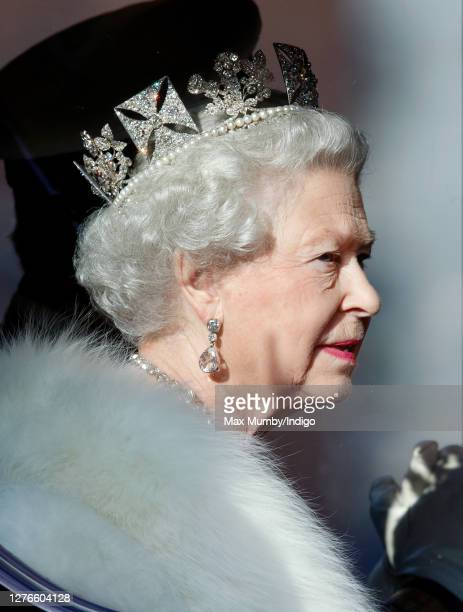 Queen Elizabeth II travels down The Mall, from Buckingham Palace to the Palace of Westminster, in the horse drawn Australian State Coach to attend...