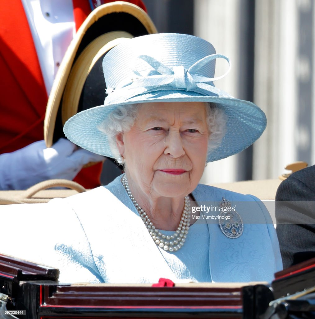 Queen Elizabeth II travels down The Mall in a horse drawn carriage during the annual Trooping the Colour Parade on June 17, 2017 in London, England. Trooping the Colour is a military parade to mark Queen Elizabeth II's official birthday and dates back to the time of Charles II in the 17th Century when the Colours of a Regiment were used as a rallying point in battle.