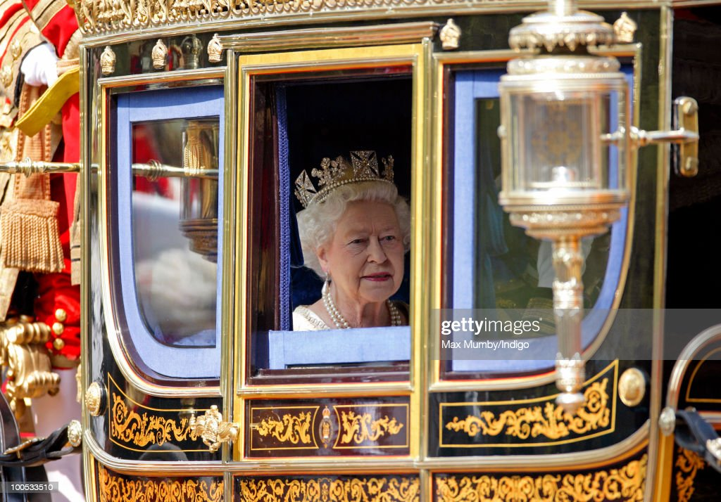 HM Queen Elizabeth II travels down The Mall in a horse drawn carriage to attend the State Opening of Parliament on May 25, 2010 in London, England. Queen Elizabeth II unveiled the new coalition government's legislative programme in a speech delivered to Members of Parliament and Peers in The House of Lords. Laws expected to be introduced in the coming Parliamentary year are thought to include new voting reforms, repeal of identity card legislation and new powers for parents to start their own schools.