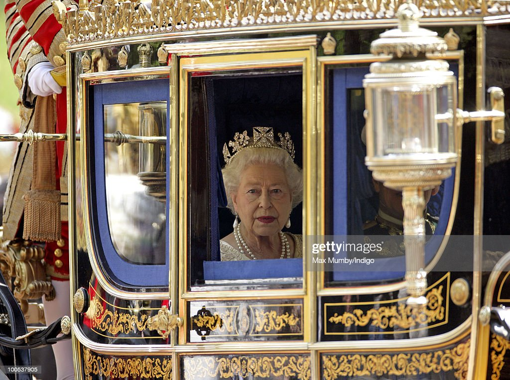 Queen Elizabeth II travels down The Mall in a horse drawn carriage to attend the State Opening of Parliament on May 25, 2010 in London, England. Queen Elizabeth II unveiled the new coalition government's legislative programme in a speech delivered to Members of Parliament and Peers in The House of Lords. Laws expected to be introduced in the coming Parliamentary year are thought to include new voting reforms, repeal of identity card legislation and new powers for parents to start their own schools.