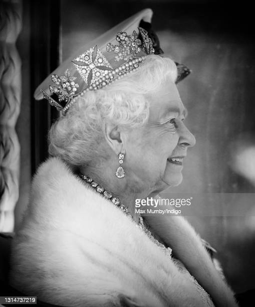 Queen Elizabeth II travels down The Mall in the Diamond Jubilee State Coach after attending the State Opening of Parliament on May 27, 2015 in...