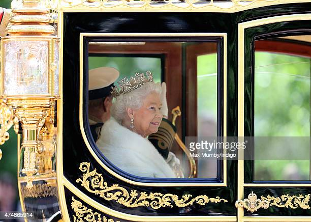 Queen Elizabeth II travels down The Mall in the Diamond Jubilee State Coach after attending the State Opening of Parliament on May 27 2015 in London...