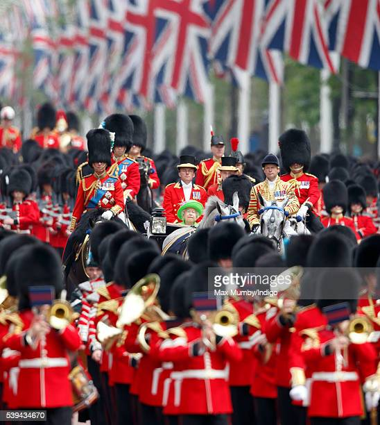 Queen Elizabeth II travels down The Mall to Buckingham Palace in a horse drawn carriage during Trooping the Colour this year marking her 90th...