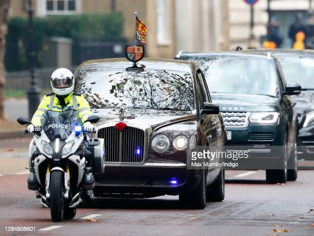 Queen Elizabeth II travels in her chauffeur driven Bentley car after attending the National Service of Remembrance at The Cenotaph on November 8 2020...