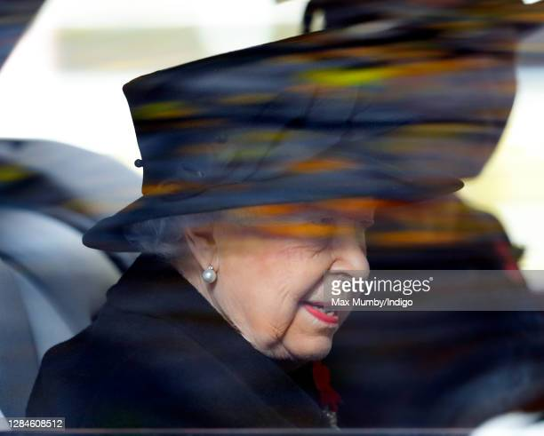 Queen Elizabeth II travels in her chauffeur driven Bentley car to attend the National Service of Remembrance at The Cenotaph on November 8 2020 in...