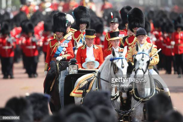 Queen Elizabeth II travels in the royal carriage during the annual Trooping The Colour parade on June 17 2017 in London England