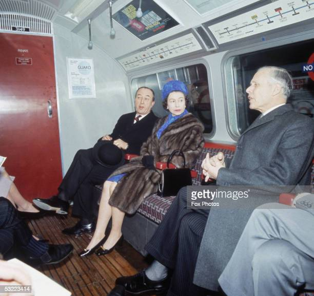 Queen Elizabeth II travels on a tube train after the official opening ceremony of London Underground's Victoria Line 7th March 1969