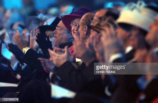 Queen Elizabeth II turns to the Duke of Edinburgh as they applaud the performance of singer Heather Small, 08 January 2004, prior to the ceremonious...