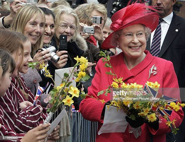 WINDSOR ENGLAND APRIL 21 Queen Elizabeth II undertakes a walkabout in Windsor Town Centre to meet the crowds who have gathered to celebrate the...