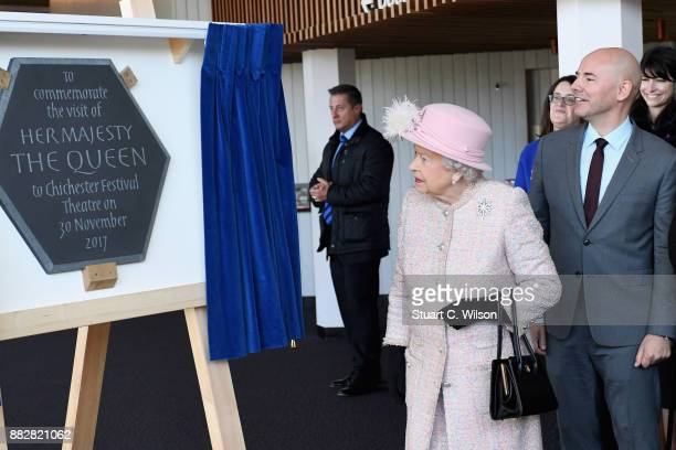 Queen Elizabeth II unveils a commemorative plaque to mark her visit to the Chichester Theatre on November 30 2017 in Chichester United Kingdom