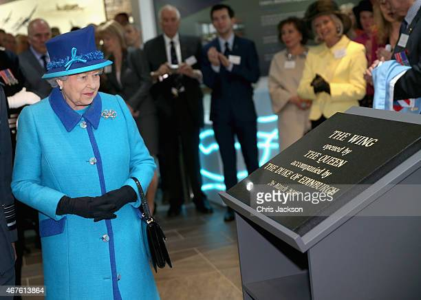 Queen Elizabeth II unveils a plaque as she opens a new wing during a visit to the National Memorial to the Few on March 26 2015 in Folkestone England