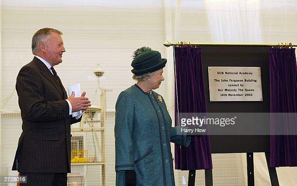 Queen Elizabeth II unveils a plaque commemorating the opening with ECB Chairman David Morgan during the official opening ceremony of the ECB National...