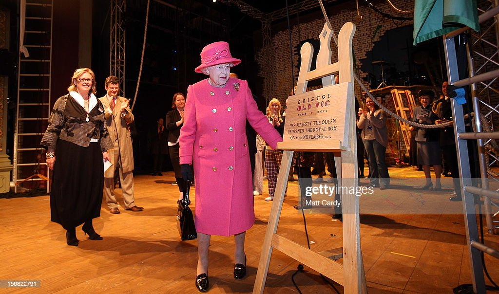 Queen Elizabeth II unveils a plaque to commemorate her visit and the completion of the work at the recently refurbished Bristol Old Vic Theatre on a visit to Bristol as part of her Jubilee Tour on November 22, 2012 in Bristol, England.