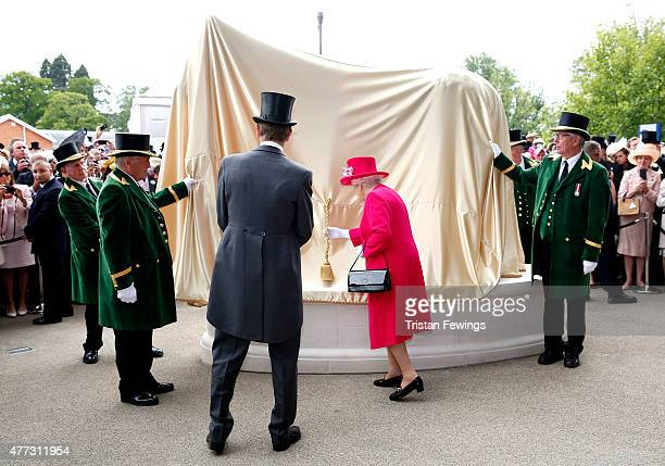 Queen Elizabeth II unveils a striking bronze statue created by sculptor Mark Coreth of legendary racehorse Frankel on the opening day of Royal Ascot...