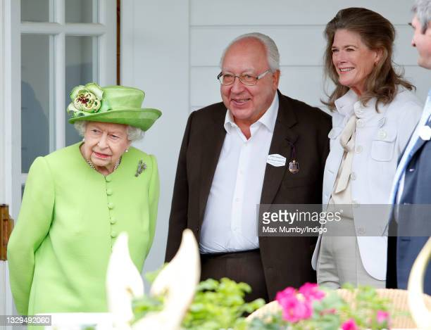 Queen Elizabeth II, Urs Schwarzenbach and Francesca Schwarzenbach attend the Out-Sourcing Inc. Royal Windsor Cup polo match and a carriage driving...