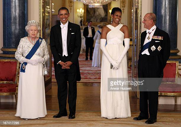 Queen Elizabeth II US President Barack Obama Michelle Obama and Prince Philip Duke of Edinburgh arrive for a state banquet at Buckingham Palace on...