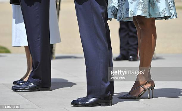 Queen Elizabeth II US President Barack Obama Prince Philip Duke of Edinburgh and US First Lady Michelle Obama stand to listen to the US National...
