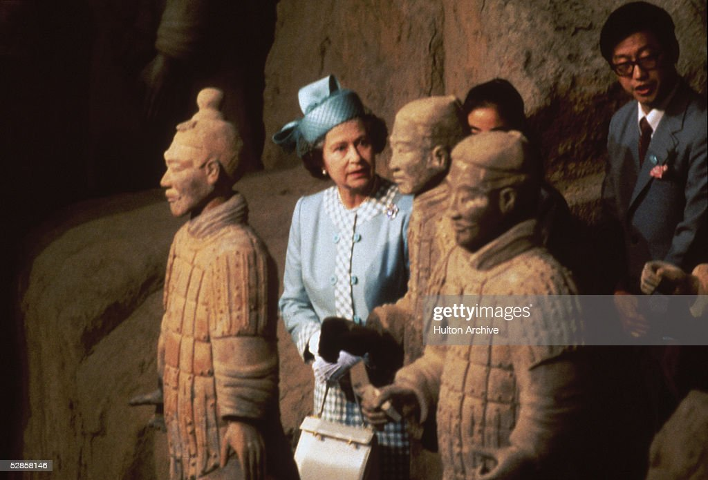 Queen Elizabeth II viewing some of the Terracotta Army soldier statues at the Qin Shi Huang's Museum Of The Terra-cotta Warriors And Horses, Shaanxi Province, during a state visit to the People's Republic Of China China, 1986.