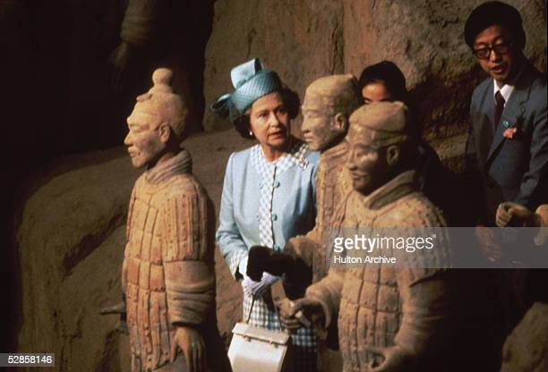 Queen Elizabeth II viewing some of the Terracotta Army soldier statues at the Qin Shi Huang's Museum Of The Terracotta Warriors And Horses Shaanxi...