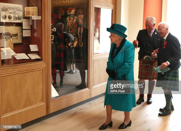 Queen Elizabeth II views an exhibition at the Duke of Rothesay Highland Games Pavilion at the Braemar Royal Highland Gathering on September 1 2018 in...