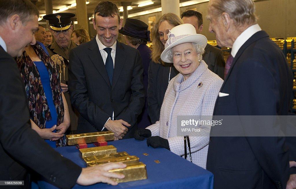 Queen Elizabeth II And The Duke Of Edinburgh Visit The Bank Of England : News Photo