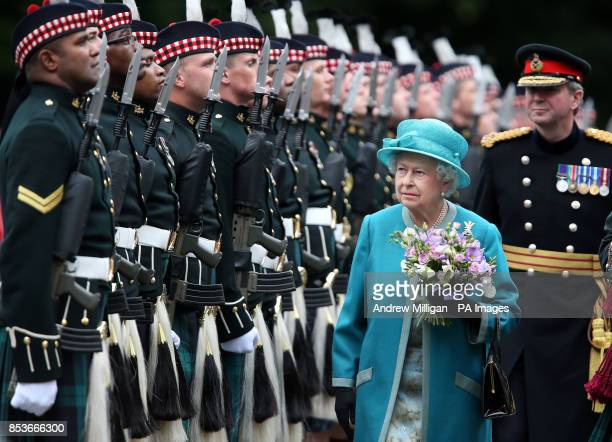 Queen Elizabeth II views the guard of honour Balaklava Company 2nd Battalion The Royal Regiment of Scotland during the Ceremony of the Keys at the...