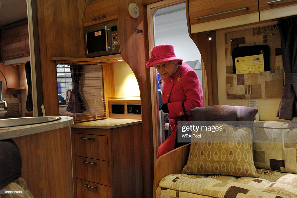 Queen Elizabeth II views the interior of a caravan during a visit to the Bailey caravan factory as part of her Jubilee tour on November 22, 2012 in Bristol, England.