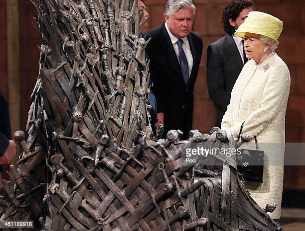 Queen Elizabeth II views the Iron Throne on the set of Game of Thrones in Belfast's Titanic Quarter on June 24 2014 in Belfast Northern Ireland The...