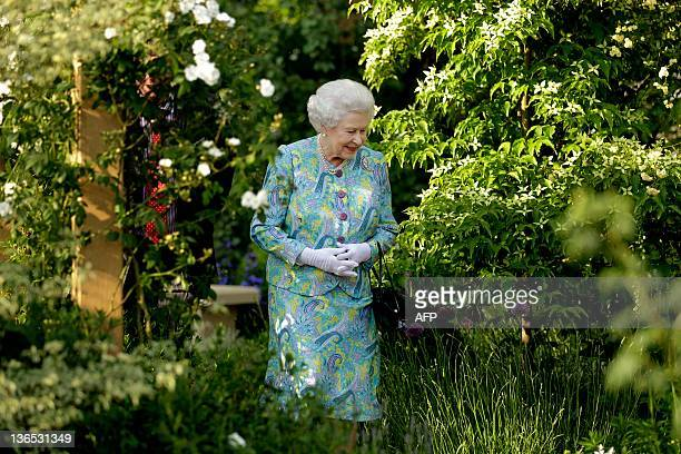 Queen Elizabeth II visits a garden at the Chelsea Flower Show in London, on May 24, 2010. The show, which has 600 exhibitors, opens to the public on...