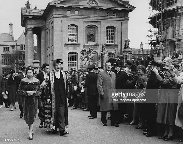 Queen Elizabeth II visits British Prime Minister Harold Macmillan Chancellor of Oxford University in Oxford 4th November 1960 They are on their way...