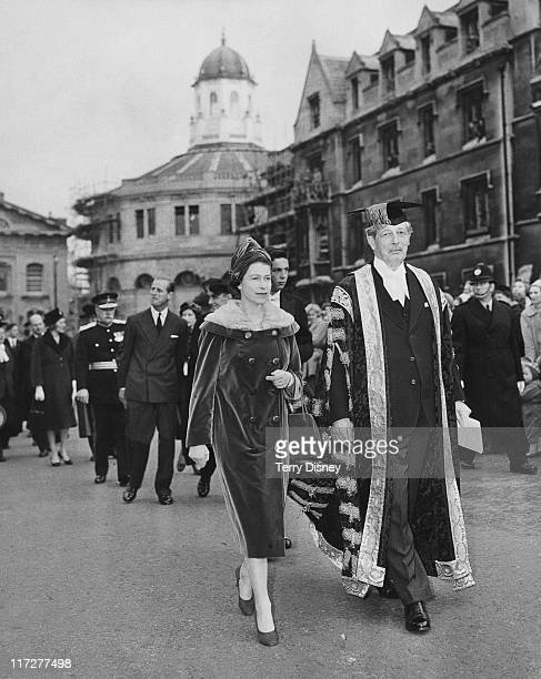 Queen Elizabeth II visits British Prime Minister Harold Macmillan Chancellor of Oxford University in Oxford 4th November 1960 They are walking along...