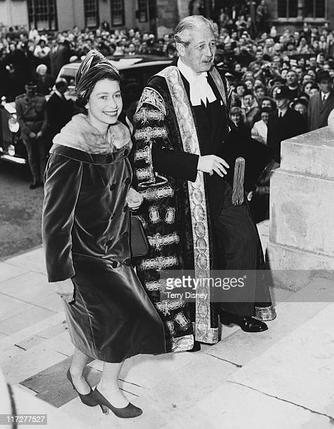 Queen Elizabeth II visits British Prime Minister Harold Macmillan , Chancellor of Oxford University, in Oxford, 4th November 1960. They are climbing...