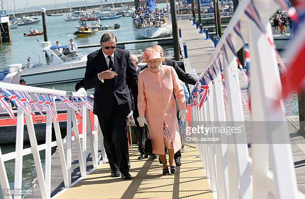 Queen Elizabeth II visits Cowes Yacht Club during her Diamond Jubilee visit to the Isle of Wight on July 25 2012 in Cowes England The Queen and Duke...