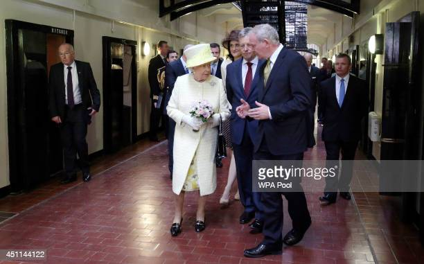 Queen Elizabeth II visits Crumlin Road Gaol with Northern Ireland's First Minister Peter Robinson and deputy First Minister Martin McGuinness on June...