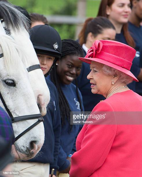 Queen Elizabeth II visits Ebony Horse Club And Community Riding Centre Brixton on October 29 2013 in London England