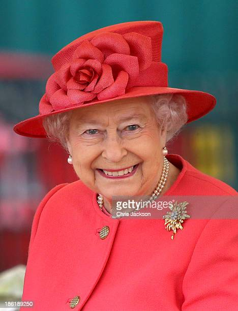 Queen Elizabeth II visits Ebony Horse Club Community Riding Centre in Brixton during a joint visit with Camilla Duchess of Cornwall on October 29...
