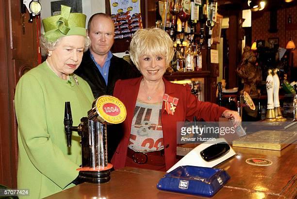 Queen Elizabeth II visits Elstree Studios where the famous British soap opera EastEnders is filmed, on November 28, 2001 in London, England. During...