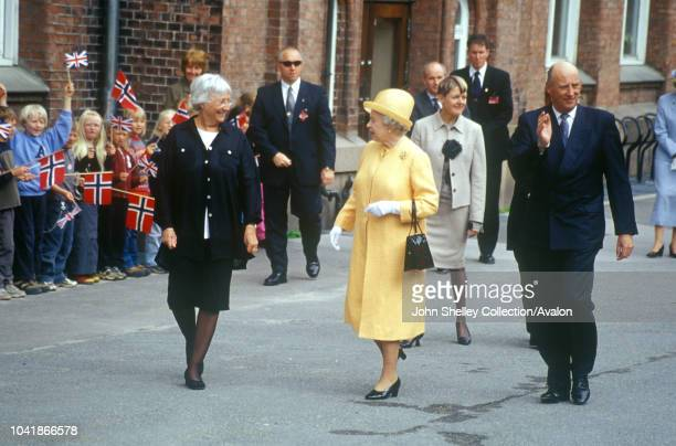 Queen Elizabeth II visits Norway Visiting a school in Oslo with King Harald V 31st May 2001