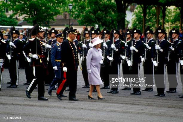 Queen Elizabeth II visits Norway, With King Harald V at the War Memorial in Oslo, 30th May 2001.