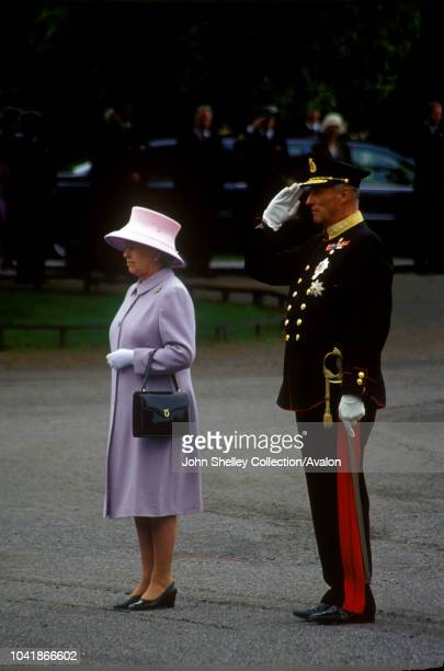 Queen Elizabeth II visits Norway With King Harald V at the War Memorial in Oslo 30th May 2001