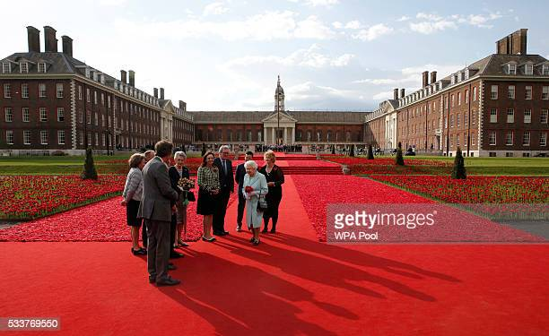Queen Elizabeth II visits the 5000 Poppies Garden at Chelsea Flower Show press day at Royal Hospital Chelsea on May 23 2016 in London England The...