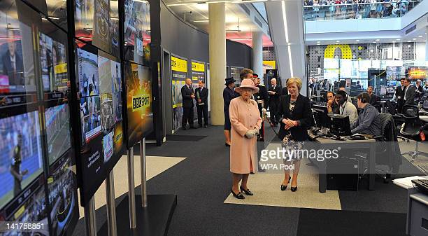 Queen Elizabeth II visits the BBC sport offices in Media City in Salford on March 23 2012 in Greater Manchester northwest England The Queen and her...