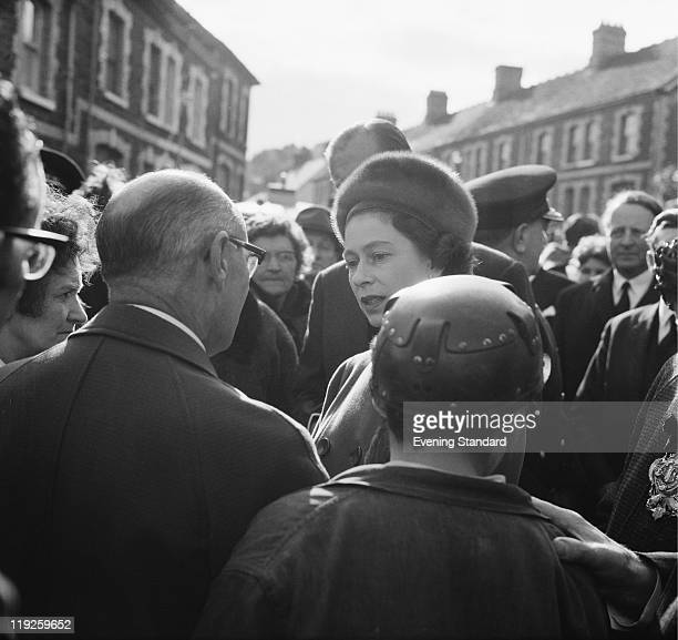 Queen Elizabeth II visits the coalmining village of Aberfan in South Wales eight days after the disaster in which 116 children and 28 adults were...